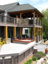love this exterior thinking about adding stone to deck beams