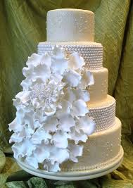 modern romantic wedding cakes with ruffles and bows by the cake