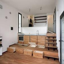 terraced studio with storage built into the stepped floor italy