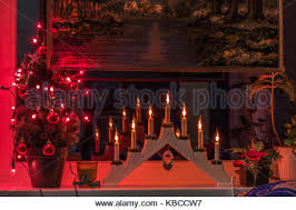 christmas wooden candle holder with electric bulbs on gray stock