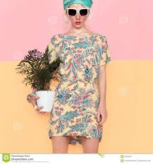 model with flower in trendy summer dress beach style stock photo