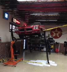 guys with 4 post car lifts in their garages i have questions