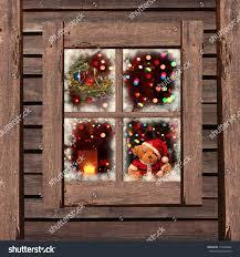 christmas lights seen through wooden cabin stock photo 110243822
