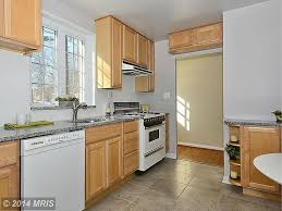 Kitchen With Maple Cabinets by New Caledonia Granite Countertops Pictures Cost Pros And Cons