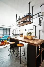 industrial style kitchen island industrial meets rustic in this kitchen wood doors kitchen design
