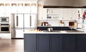 black cabinets gray solid countertop dark bar stools large mirror