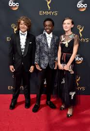millie bobby brown looks like an angelic queen at the emmys