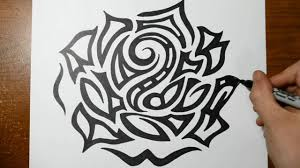 drawing a large detailed tribal rose head tattoo design sketch