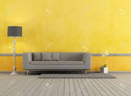 Modern Sofa by Gray Modern Sofa In A Yellow Living Room Rendering Stock Photo
