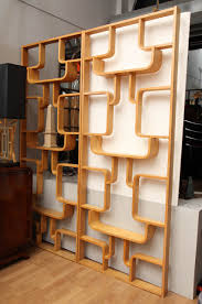 pair of room dividers or bookcases iconic design by drevopodnik