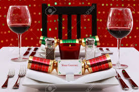 photo of a restaurant table with christmas place settings with