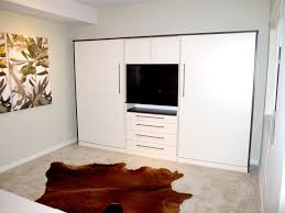 small white murphy bed with desk integrated living room tv unit