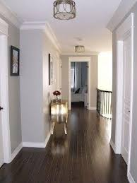 dark floors soft grey wall colour and white moulding love it