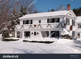 attractive white house vermont covered snow stock photo 25578688