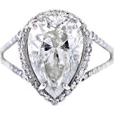 shaped engagement ring white gold pear shaped diamond halo style pave engagement ring