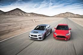 subaru confidence in motion logo png 2014 ford focus st vs 2015 subaru wrx comparison motor trend