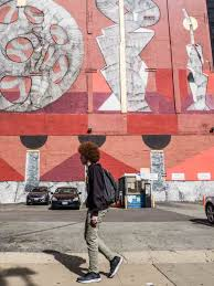 a neighborhood guide to discovering chicago street art red mural on wabash street art corridor
