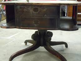 well liked round high foyer table with four legs as small space