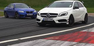 bmw m235i manual manual bmw m235i goes up against a45 amg on the track autoevolution