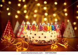 birthday cake candles happy birthday candles on birthday cake with melting wax stock