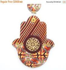 the love hamsa handmade of polymer clay home decor by artefyk