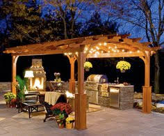 deck decorating ideas pergola lights and cement planters deck