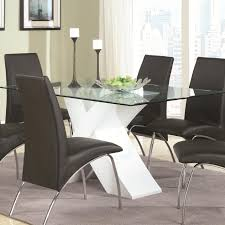 contemporary glass top dining table with white x pedestal by