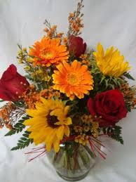 Gerbera Daisies A Fall Favorite Roses Gerbera Daisies And Sunflowers Arranged