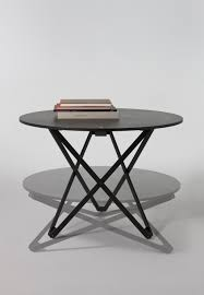adjustable height round table a multipurpose round table with a wooden top and articulated legs