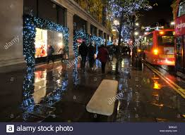 Christmas Decorations Oxford Street - rainy day in oxford street with shoppers and christmas decorations