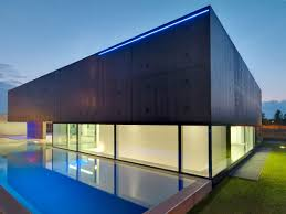 lighting pool evening concrete and glass home in urgnano italy
