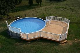 unique pool in backyard with large deck for above ground part of