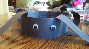 add some googly eyes to your spider headband craft to give him