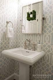 chic powder room features top half of walls clad in beige
