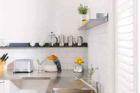 stainless steel kitchen backsplash tiles white kitchen with stainless steel countertops and black shelf