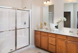 a large sit in shower double vanity walk in closet and washer