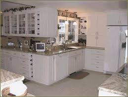 Painting Melamine Kitchen Cabinet Doors by Cabinet Painting Melamine Kitchen Cabinet