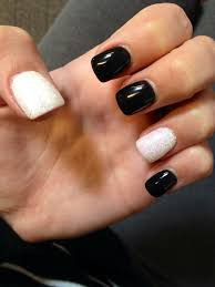 black gel nails with white and glitter dipped gel accent nails