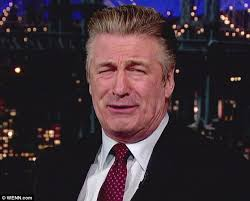 looking with grey hair alec baldwin embraces the grey after ditching his 30 rock hair dye