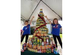 family builds six foot tree out of canned food donates it