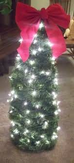 christmas tree with white lights and red bows this little light tomato cage trees