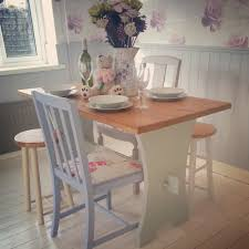 a beautiful shabby chic solid pine table with 2 chairs and 2
