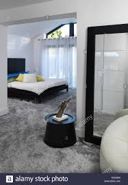contemporary double bedroom looking through from dressing area uk