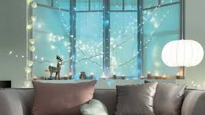 for by decorating the window with cords of white lights