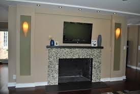modern electric fireplace with glass mantel in luxury living room