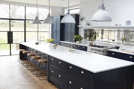 Burrows Central Texas Builder Gray Dark Blue Kitchen Cabinets
