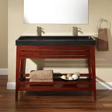 cherry blossom mahogany vanity with black granite trough sink