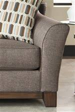 ashley furniture janley sofa janley contemporary sofa with front wood rail belfort furniture