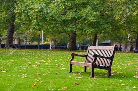 park bench in london on a autumn cloudy day stock photo picture