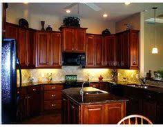 Dark Cherry Wood Kitchen Cabinets Cherry Wood Kitchen Cabinets With Silver Appliances And Black